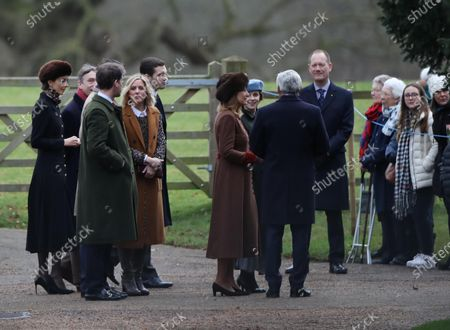 Stock Picture of The Marchioness of Cholmondeley (left, with faux fur hat) and Carole Middleton were amongst the congregation