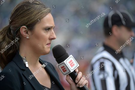 Television sideline reporter Allison Williams works from the field during warmups before the Camping World Bowl NCAA college football game between Notre Dame and Iowa State, in Orlando, Fla