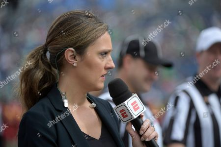 Stock Picture of Television sideline reporter Allison Williams works from the field during warmups before the Camping World Bowl NCAA college football game between Notre Dame and Iowa State, in Orlando, Fla