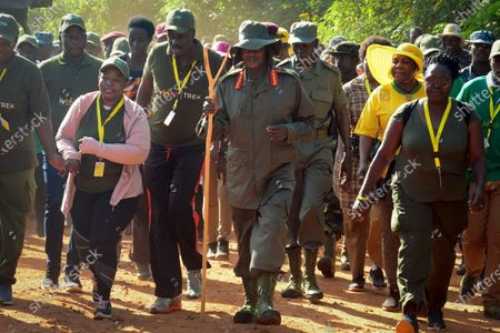 Ugandan President Yoweri Museveni (C) is accompanied by others as he starts his six-day 200km trek retracing the route his forces took in 1986 when he took the power, in Galamba, north of Kampala, Uganda, 04 January 2019 (issued 06 January 2019). Seventy five-year-old Museveni, one of Africa's longest-serving leaders, began the trek dubbed 'Africa Kwetu' (Africa our homeland) on 04 January 2019 and plans to finish it on 10 January. The walk has been criticized by pop star-turned-opposition politician Bobi Wine whom Museveni will face in the 2020 elections, according to reports.