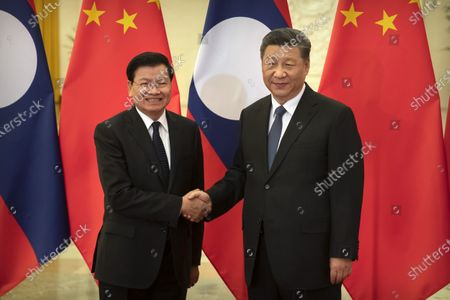 Laos' Prime Minister Thongloun Sisoulith (L) and Chinese President Xi Jinping shake hands before a meeting at the Great Hall of the People in Beijing, China, 06 January 2020.