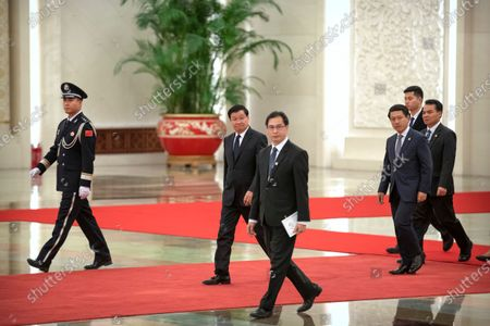 Laos' Prime Minister Thongloun Sisoulith (C) arrives for a meeting with Chinese President Xi Jinping at the Great Hall of the People in Beijing, China, 06 January 2020.