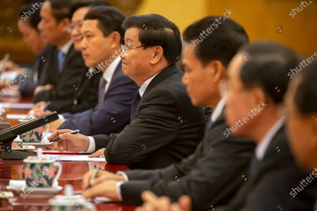 Stock Photo of Laos' Prime Minister Thongloun Sisoulith (C) listens as Chinese President Xi Jinping speaks during a meeting at the Great Hall of the People in Beijing, China, 06 January 2020.