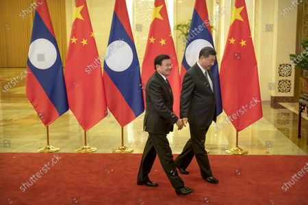 Stock Image of Laos' Prime Minister Thongloun Sisoulith (L) and Chinese President Xi Jinping walk together before a meeting at the Great Hall of the People in Beijing, China, 06 January 2020.