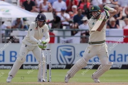 South Africa's batsman Piter Malan plays a shot while England's wicketkeeper Jos Buttler watches on during day four of the second cricket test between South Africa and England at the Newlands Cricket Stadium in Cape Town, South Africa