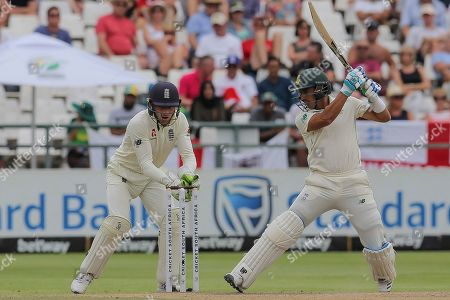 South Africa's batsman Zubayr Hamza plays a shot while Englands wicketkeeper Jos Buttler watches on during day four of the second cricket test between South Africa and England at the Newlands Cricket Stadium in Cape Town, South Africa