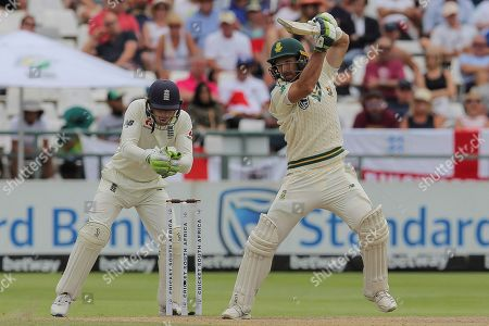 South Africa's batsman Pieter Malan plays a shot while Englands wicketkeeper Jos Buttler watches on during day four of the second cricket test between South Africa and England at the Newlands Cricket Stadium in Cape Town, South Africa