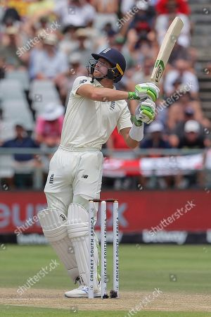 England's batsman Jos Buttler in action during day four of the second cricket test between South Africa and England at the Newlands Cricket Stadium in Cape Town, South Africa