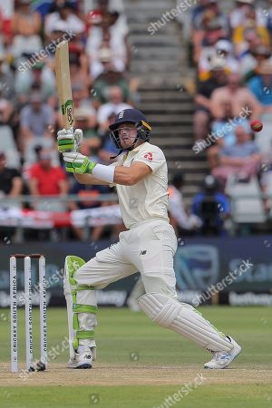 England's batsman Jos Buttler plays an unorthodox shot which led to his dismissal during day four of the second cricket test between South Africa and England at the Newlands Cricket Stadium in Cape Town, South Africa