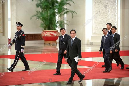 Laos' Prime Minister Thongloun Sisoulith, center, arrives for a meeting with Chinese President Xi Jinping at the Great Hall of the People in Beijing