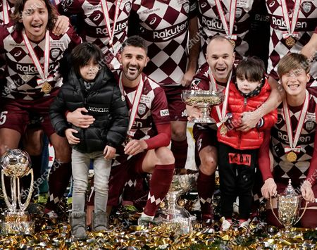 Stock Picture of Captain Andres Iniesta (C-R) and David Villa (C-L) of Vissel Kobe celebrates with their daughters and the Emperor's Cup after winning the Emperor's Cup final over Kashima Antlers at new National Stadium in Tokyo, Japan, 01 January, 2020. The stadium is the main stadium for Tokyo 2020 Olympic and Paralympic Games. Kobe won the Emperor's Cup.