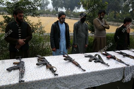 Editorial photo of Militants surrender their weapons as part of reconciliation initiative, Jalalabad, Afghanistan - 06 Jan 2020