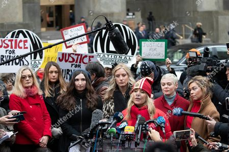 Rosanna Arquette speaks at a news conference outside a Manhattan courthouse after Harvey Weinstein arrived, in New York. Behind her are, left to right, Louise Godbold, Dominique Huett, Sarah Ann Masse, Paula Williams, Rose McGowan, and Lauren Sivan. The disgraced movie mogul faces allegations of rape and sexual assault