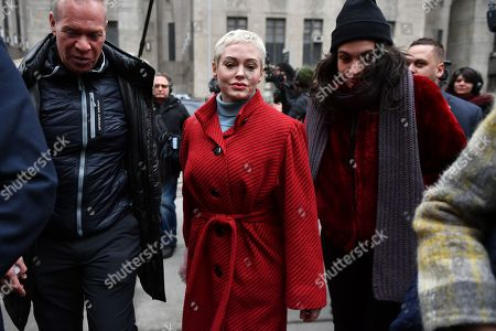 Rose McGowan speaks at a press conference outside the Criminal Court in New York.