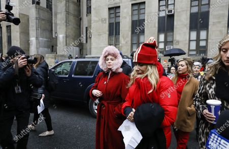 Actresses Rose McGowan (L), Rosanna Arquette (2-L) and Lauren Sivan, who have all accused former Hollywood producer Harvey Weinstein of sexual assault, walk together to a press conference outside New York State Supreme Court on the first day of Weinstein's criminal trial in New York, New York, USA, 06 January 2020. The trial, which is expected to last for about eight weeks, is based on sexual assault and rape allegations of two other women.