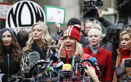 Actress Rosanna Arquette (3-R) speaks to journalist while stand with other women who have all accused former Hollywood producer Harvey Weinstein of sexual assault, including Rose McGowan (2-R) and television journalist Lauren Sivan (R), during a press conference outside New York State Supreme Court on the first day of Weinstein's criminal trial in New York, New York, USA, 06 January 2020. The trial, which is expected to last for about eight weeks, is based on sexual assault and rape allegations of two other women.