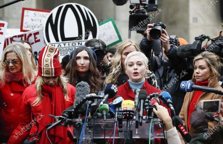Actress Rose McGowan (2-R) talks to journalists during a press conference with other women who have all accused former Hollywood producer Harvey Weinstein of sexual assault, including Patricia Arquette (2-R) and television journalist Lauren Sivan (R), outside New York State Supreme Court on the first day of Weinstein's criminal trial in New York, New York, USA, 06 January 2020. The trial, which is expected to last for about eight weeks, is based on sexual assault and rape allegations of two other women.