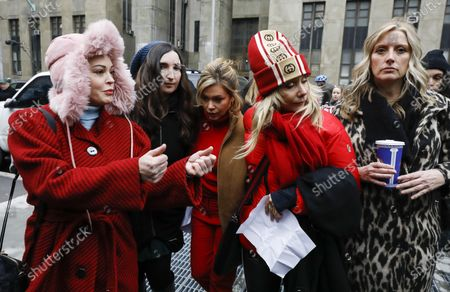 Rose McGowan (L), Lauren Sivan (3-L) and Patricia Arquette (2-R), who have all accused former Hollywood producer Harvey Weinstein of sexual assault, walk together to a press conference outside New York State Supreme Court on the first day of Weinstein's criminal trial in New York, New York, USA, 06 January 2020. The trial, which is expected to last for about eight weeks, is based on sexual assault and rape allegations of two other women.