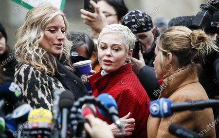 Actresses Paula Williams (L), Rose McGowan (C) and Lauren Sivan (R) stand together during a press conference with women who have all accused former Hollywood producer Harvey Weinstein of sexual assault outside New York State Supreme Court on the first day of Weinstein's criminal trial in New York, New York, USA, 06 January 2020. The trial, which is expected to last for about eight weeks, is based on sexual assault and rape allegations of two other women.