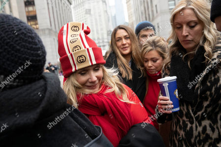 Actor Rosanna Arquette, left, arrives at a courthouse after the arrival of Harvey Weinstein, in New York. Actor Rose McGowan, right, listens. Weinstein is on trial on charges of rape and sexual assault, more than two years after a torrent of women began accusing him of misconduct