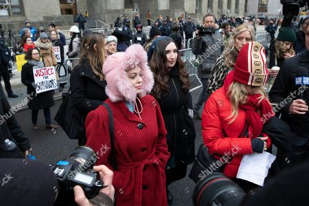Actors Rose McGowan, center, and Rosanna Arquette, right, arrive at a news conference outside a Manhattan courthouse after the arrival of Harvey Weinstein, in New York. Weinstein is on trial on charges of rape and sexual assault, more than two years after a torrent of women began accusing him of misconduct