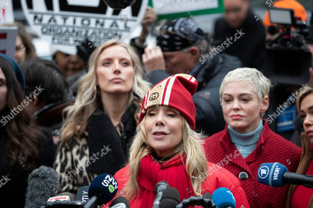 Paula Williams, left, Rosanna Arquette, center, and Rose McGowan attend a news conference outside a Manhattan courthouse after Harvey Weinstein arrived, in New York. Weinstein is on trial on charges of rape and sexual assault, more than two years after a torrent of women began accusing him of misconduct