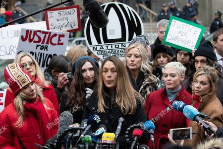 Stock Photo of Dominique Huett, center, speaks at a news conference outside a Manhattan courthouse after Harvey Weinstein arrived, in New York. Weinstein is on trial on charges of rape and sexual assault, more than two years after a torrent of women began accusing him of misconduct
