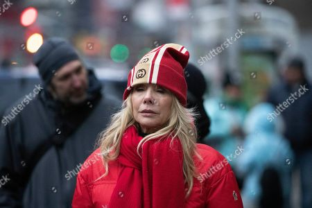 Rosanna Arquette waits outside a Manhattan courthouse for the arrival of Harvey Weinstein, in New York. Weinstein is on trial on charges of rape and sexual assault, more than two years after a torrent of women began accusing him of misconduct