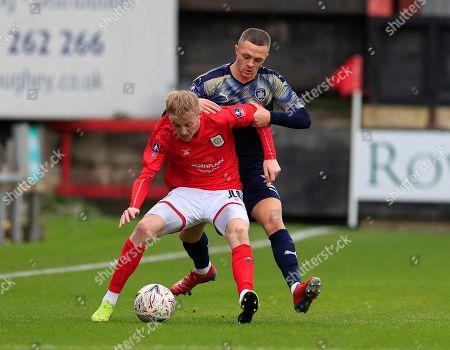 Charlie Kirk (10) of Crewe Alexandra and Jordan Williams (2) of Barnsley challenge for the ball.