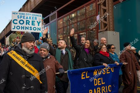 New York City Council Speaker Corey Johnson waves to crowd at the annual 'Three King's Day' parade in East Harlem, sponsored by El Museo del Barrio.
