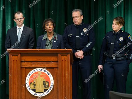 Paul Thompson, Jackie Lacey, Michel Moore, Sandra Spagnoli. Los Angeles County District Attorney Jackie Lacey, at podium, announces that film producer Harvey Weinstein has been charged with raping a woman and sexually assaulting another in separate incidents over a two-day period in 2013, at a news conference at the Hall of Justice in Los Angeles,. From left, Paul Thompson, Los Angeles County District Deputy Attorney, Lacey, Michel Moore, Chief of the Los Angeles Police Department, and Sandra Spagnoli, Chief of Police, Beverly Hills, Calif