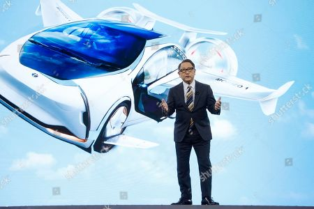 With a shared mobility concept vehicle, Toyota CEO Akio Toyoda talks about building the prototype Toyota city of the future, called the Woven City that will be a fully connected ecosystem powered by hydrogen fuel cells, before the CES tech show, in Las Vegas