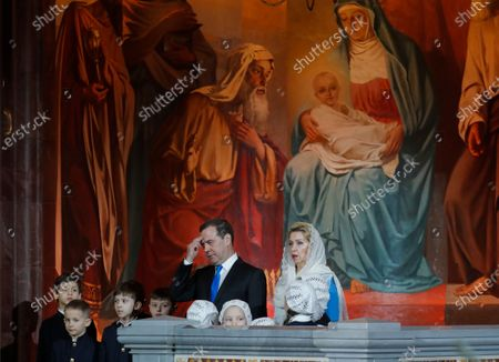 Russian Prime Minister Dmitry Medvedev (C) and his wife Svetlana Medvedeva (R) attend a midnight Christmas service at Christ the Savior cathedral in Moscow, Russia, 06 January 2020. The Russian Orthodox church celebrates Christmas on 07 January according to the Julian calendar.
