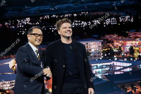 Toyota CEO Akio Toyoda, left, smiles as he is joined on stage by Danish architect Bjarke Ingels, right, CEO of Bjarke Ingels Group, after both talked about building the prototype Toyota city of the future, called the Woven City that will be a fully connected ecosystem powered by hydrogen fuel cells, before the CES tech show, in Las Vegas