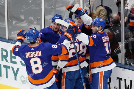 Stock Photo of Anders Lee, Noah Dobson, Michael Dal Colle, Derick Brassard. New York Islanders left wing Anders Lee (27), second from right with his back against the glass, celebrates with teammates, including defenseman Noah Dobson (8), left wing Michael Dal Colle (28), and center Derick Brassard (10) after scoring a goal during the third period of an NHL hockey game, in Uniondale, N.Y. The Islanders defeated the Avalanche 1-0 on Lee's game-winning goal