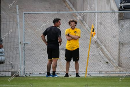 Stock Image of Penarol coach Diego Forlan (R) and player Cristian Rodriguez (L) talk during the first training of the year, at the Campeon del Siglo Stadium, in Montevideo, Uruguay, 06 January 2020. The Uruguayan former soccer player Diego Forlqn led his first training as a new coach of Penarol.