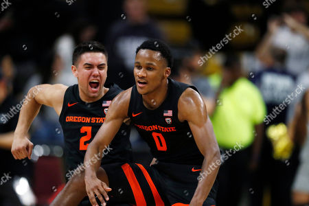 R m. Oregon State guard Jarod Lucas (2) and Oregon State guard Gianni Hunt (0) celebrate as time runs out in the second half of an NCAA college basketball game, in Boulder, Colo. Oregon State came from behind to win 76-68