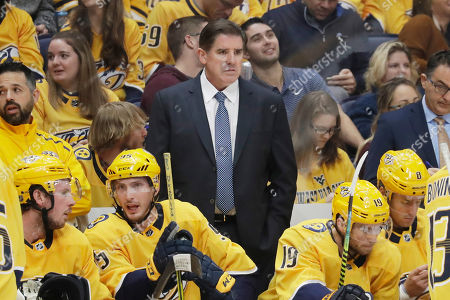 In this Oct. 8, 2019, photo, Nashville Predators head coach Peter Laviolette watches the action in an NHL hockey game against the San Jose Sharks in Nashville, Tenn. The team announced, that both Laviolette and associate coach Kevin McCarthy have been fired