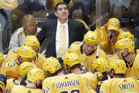 In this Oct. 5, 2019, photo, Nashville Predators head coach Peter Laviolette looks at the scoreboard in the third period of an NHL hockey game against the Detroit Red Wings in Nashville, Tenn. The team announced, that both Laviolette and associate coach Kevin McCarthy have been fired