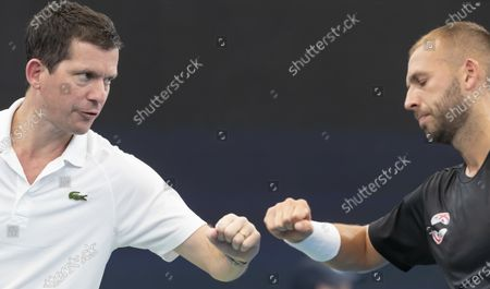 Daniel Evans of Great Britain (R) celebrates with coach Tim Henman (L) after winning against Radu Albot of Moldova (not pictured) during day five of the ATP Cup tennis tournament at Ken Rosewall Arena in Sydney, Australia, 07 January 2020.