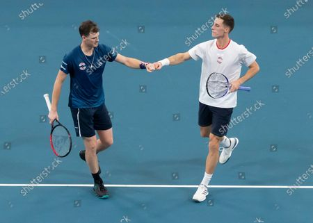 Jamie Murray (L) and Joe Salisbury (R) of Great Britain react while playing against Radu Albot and Alexander Cozbinov of Moldova (not pictured) during day five of the ATP Cup tennis tournament at Ken Rosewall Arena in Sydney, Australia, 07 January 2020.