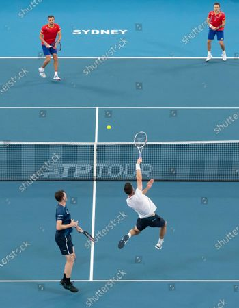 Jamie Murray (L, bottom) and Joe Salisbury (R, bottom) of Great Britain in action against Radu Albot and Alexander Cozbinov of Moldova during day five of the ATP Cup tennis tournament at Ken Rosewall Arena in Sydney, Australia, 07 January 2020.