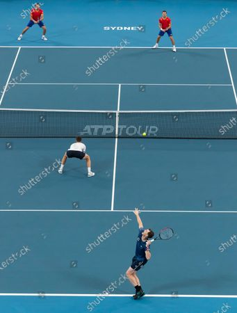 Stock Image of Jamie Murray (r, bottom) and Joe Salisbury (l, bottom) of Great Britain in action against Radu Albot and Alexander Cozbinov of Moldova during day five of the ATP Cup tennis tournament at Ken Rosewall Arena in Sydney, Australia, 07 January 2020.