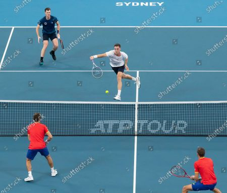 Jamie Murray (L, top) and Joe Salisbury (R, top) of Great Britain in action against Radu Albot and Alexander Cozbinov of Moldova during day five of the ATP Cup tennis tournament at Ken Rosewall Arena in Sydney, Australia, 07 January 2020.