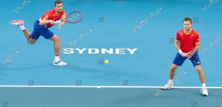 Stock Photo of Radu Albot (L) and Alexander Cozbinov (R) of Moldova in action against Jamie Murray and Joe Salisbury of Great Britain (not pictured) during day five of the ATP Cup tennis tournament at Ken Rosewall Arena in Sydney, Australia, 07 January 2020.
