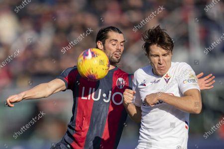 Andrea Poli of Bologna and Federico Chiesa of Fiorentina