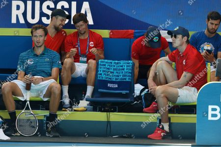 Russia's Daniil Medvedev sits at the opposite end of the team bench to Russian Captain Marat Safin in a points break against Norway's Casper Ruud during their match at the ATP Cup in Perth, Australia