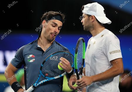 Fabio Fognini (L) and Simone Bolelli of Italy talk during the doubles match against Rajeev Ram and Austin Krajicek of the USA  on day 5 of the ATP Cup tennis tournament at RAC Arena in Perth, Australia, 07 January 2020.