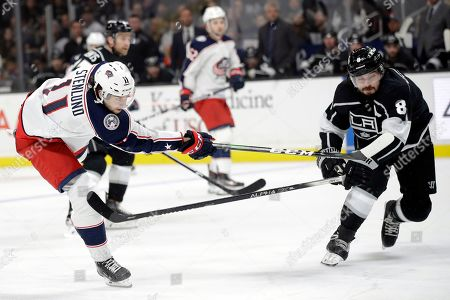 Kevin Stenlund, Drew Doughty. Columbus Blue Jackets' Kevin Stenlund, left, shoots to score past Los Angeles Kings' Drew Doughty during the third period of an NHL hockey game, in Los Angeles