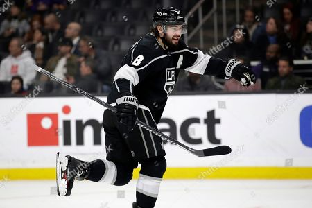 Los Angeles Kings' Drew Doughty jokes with goaltender Jonathan Quick during the first period of an NHL hockey game against the Columbus Blue Jackets, in Los Angeles